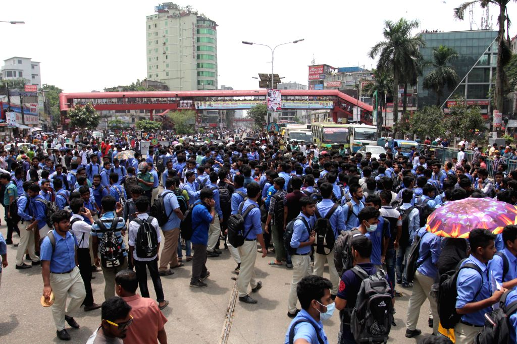 DHAKA, July 31, 2018 - Students block a major road in protest over deaths of their friends in an accident in Dhaka, Bangladesh on July 31, 2018. Students were run over by a bus on a highway linking ...