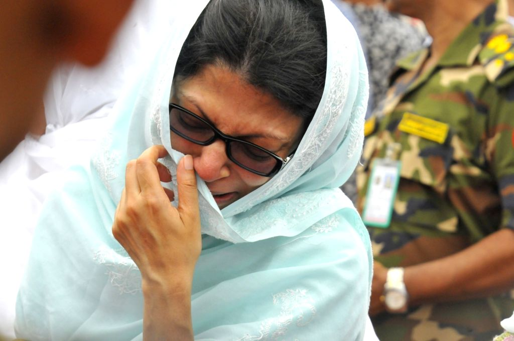 DHAKA, July 4, 2016 - A family member of a victim mourns during a memorial service for those killed in a bloody siege at the Army Stadium in Dhaka, Bangladesh, July 4, 2016. Nine Italians, seven ...