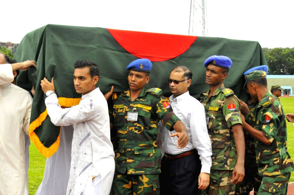 DHAKA, July 4, 2016 - Bangladesh Army soldiers carry a coffin containing the body of a victim during a memorial service for those killed in a bloody siege at the Army Stadium in Dhaka, Bangladesh, ...
