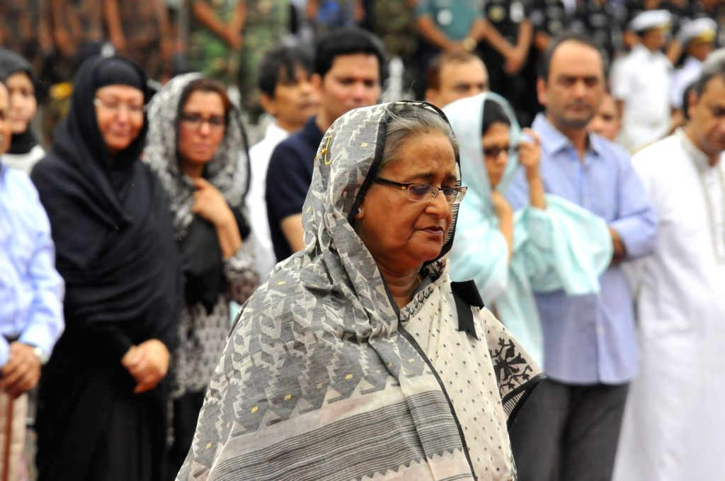DHAKA, July 4, 2016 - Bangladeshi Prime Minister Sheikh Hasina pays respect to victims during a memorial service for those killed in a bloody siege at the Army Stadium in Dhaka, Bangladesh, July 4, ... - Sheikh Hasina