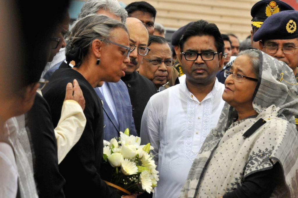 DHAKA, July 4, 2016 - Bangladeshi Prime Minister Sheikh Hasina (R) talks with U.S. Ambassador to Bangladesh Marcia Stephens Bloom Bernicat (L) during a memorial service for those killed in a bloody ... - Sheikh Hasina