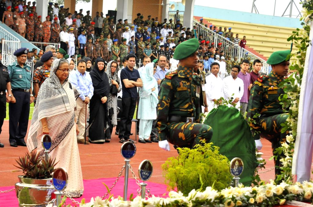 DHAKA, July 4, 2016 - Bangladeshi Prime Minister Sheikh Hasina (L) pays respect to victims during a memorial service for those killed in a bloody siege at the Army Stadium in Dhaka, Bangladesh, July ... - Sheikh Hasina