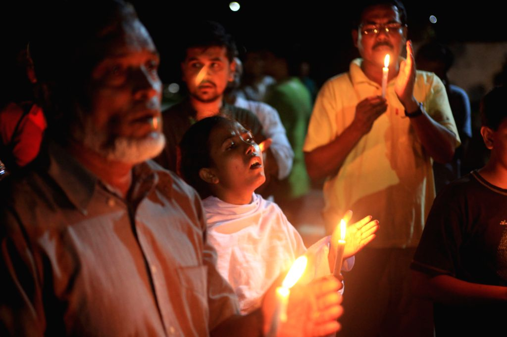 DHAKA, July 4, 2016 - Bangladeshi social activists hold candles in memory of victims killed in an attack in Dhaka's diplomatic enclave Gulshan, Bangladesh, July 3, 2016. With all the national flags ...