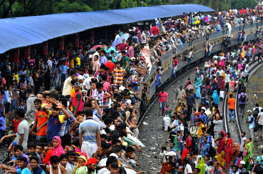 DHAKA, July 5, 2016 - Passengers travel on top of a train leaving for their hometowns for the upcoming Eid al-Fitr festival in Dhaka, Bangladesh, July 5, 2016.