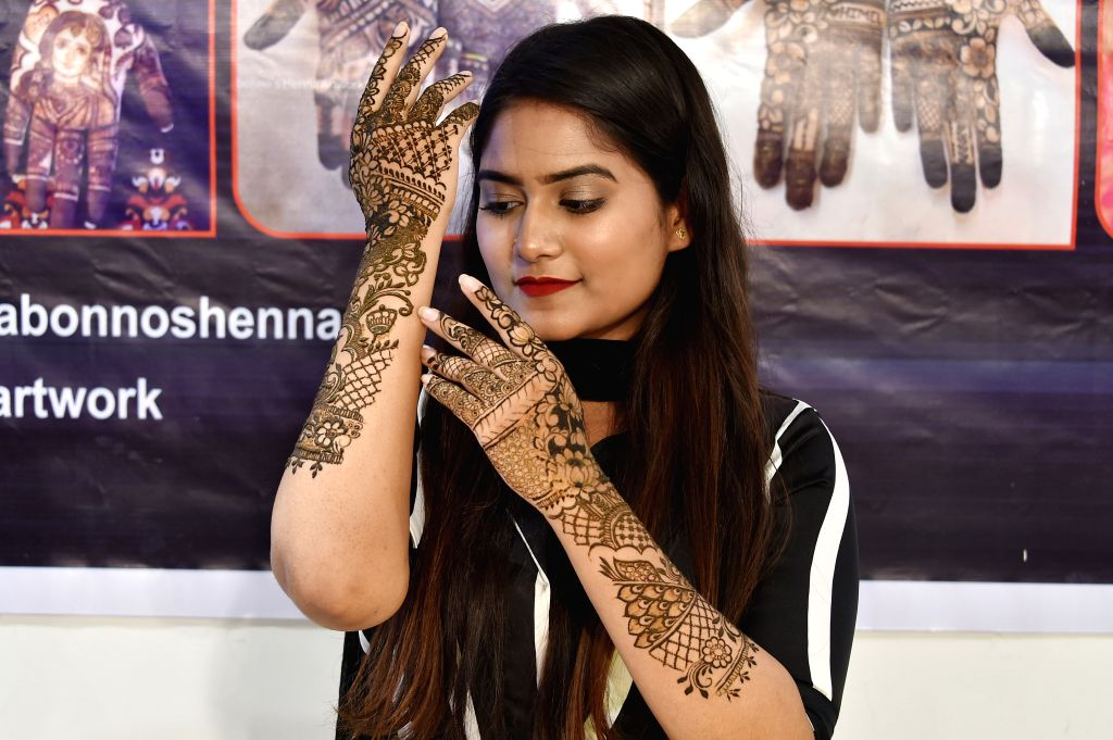 DHAKA, June 1, 2019 - A girl shows traditional skin art painted on her hands in Dhaka, Bangladesh, June 1, 2019.