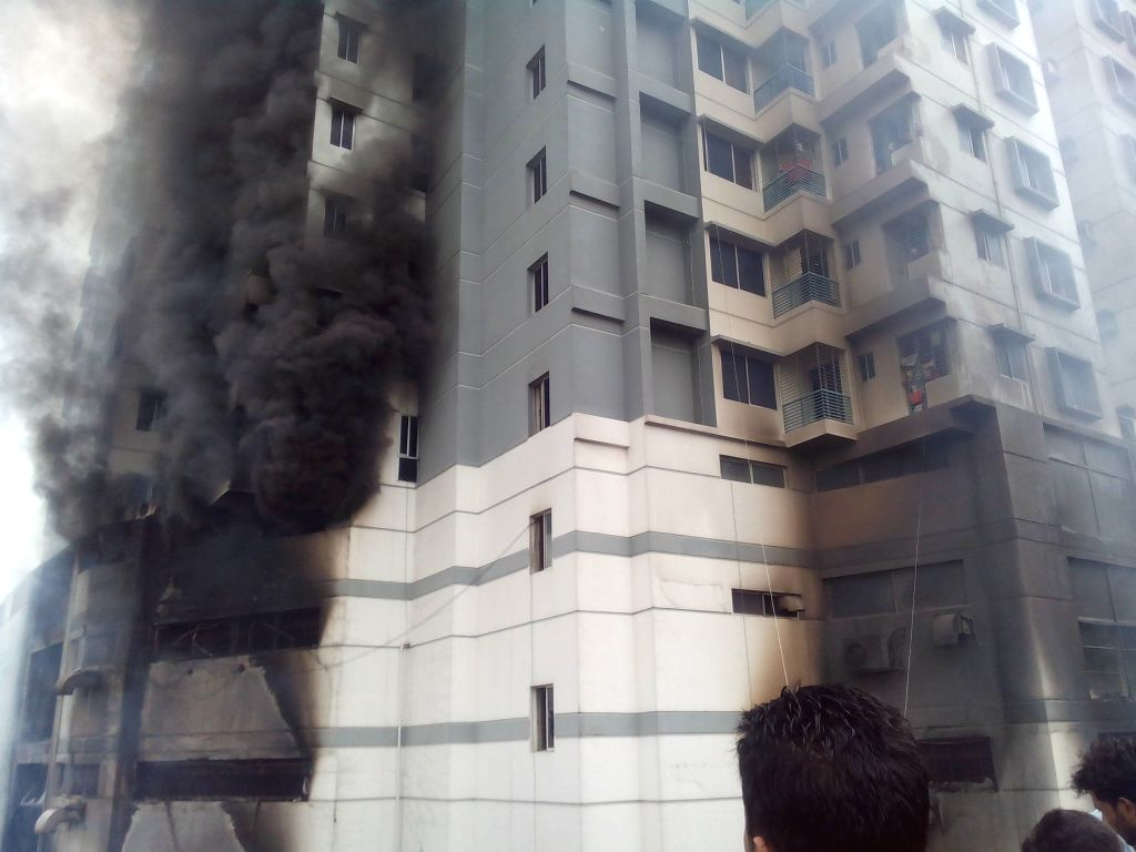 DHAKA, June 29, 2016 - Photo taken on June 29, 2016 shows a fire broke out in a residential multi-story building at Uttar Badda in Dhaka, Bangladesh, June 29, 2016.