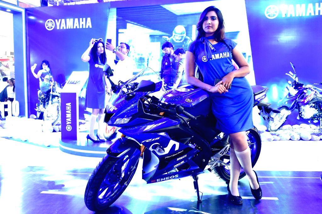 DHAKA, March 14, 2019 - A model poses beside a motor cycle at a motor show in Dhaka, capital of Bangladesh, on March 14, 2019. Bangladesh's biggest international automotive exhibition kicked off in ...