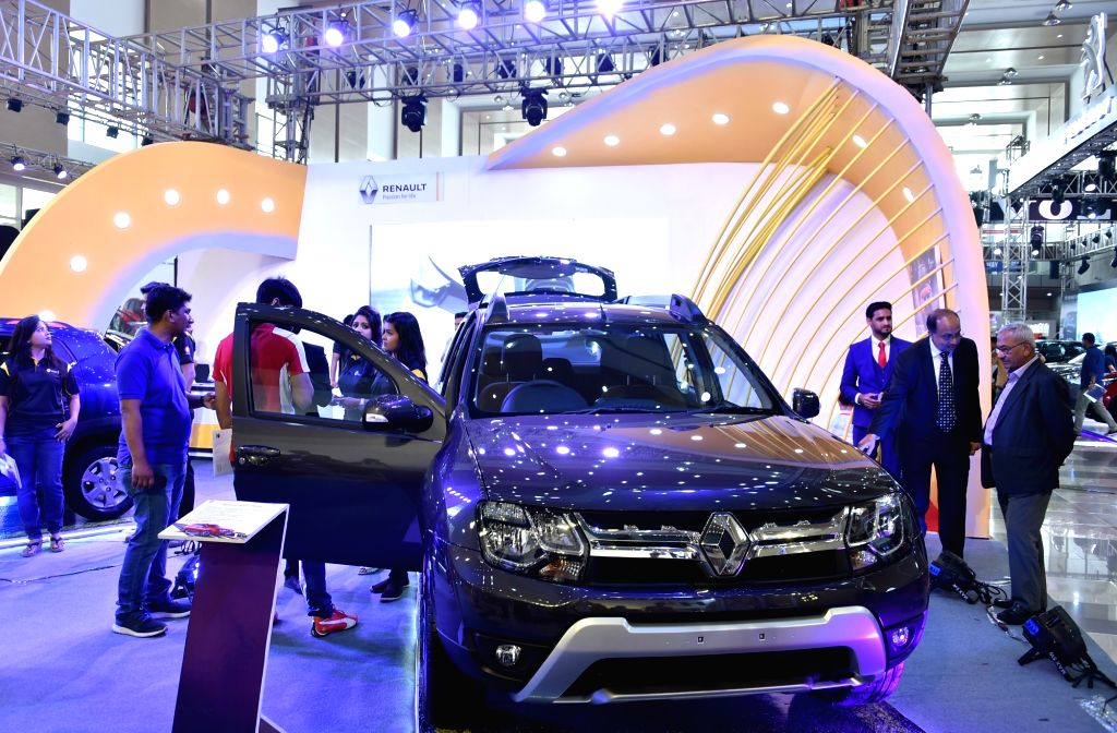 DHAKA, March 14, 2019 - Visitors view a car at a motor show in Dhaka, capital of Bangladesh, on March 14, 2019. Bangladesh's biggest international automotive exhibition kicked off in capital Dhaka on ...