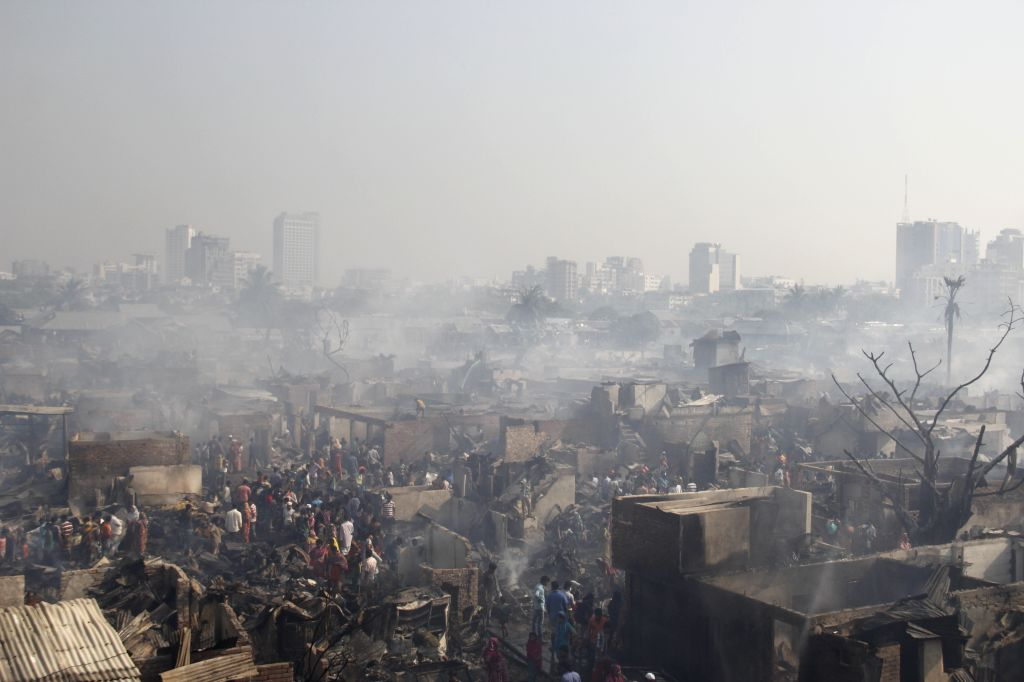 DHAKA, March 16, 2017 - Photo taken on March 16, 2017 shows the slum after a devastating fire in Dhaka, capital of Bangladesh. A devastating fire swept through one of the largest slums in Bangladesh ...
