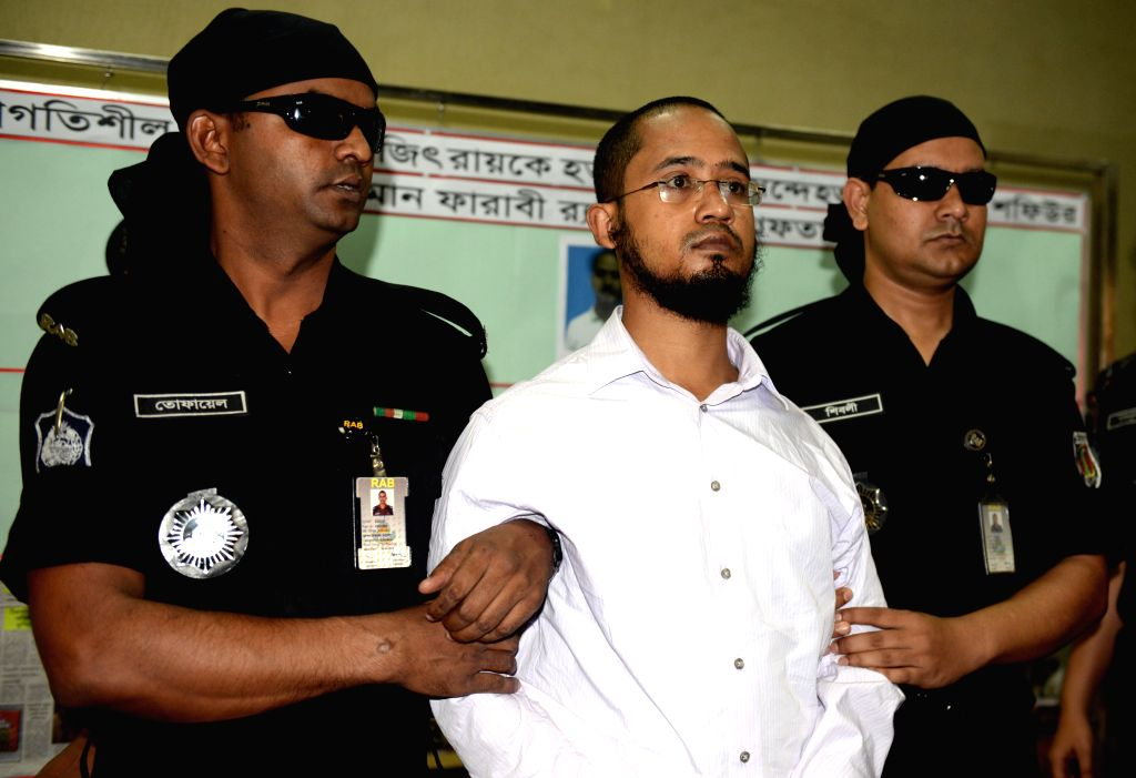 Farabi Shafiur Rahman (C), the prime suspect in a murder case of writer-blogger Avijit Roy, is arrested by Rapid Action Battalion (RAB) in Dhaka, Bangladesh, March 2, ... - Avijit Roy