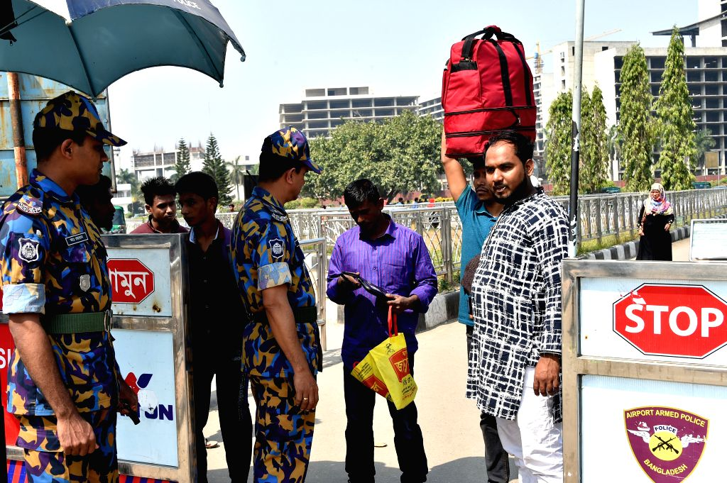 DHAKA, March 3, 2019 - Bangladeshi policemen conduct security check at the entrance of the Hazrat Shajalal International Airport in Dhaka, Bangladesh, on March 3, 2019. Bangladesh has tightened ...
