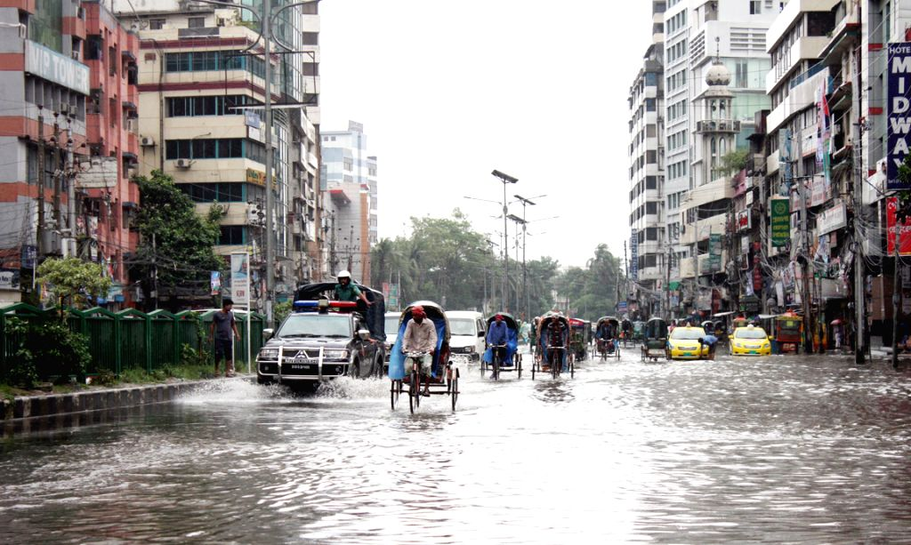 DHAKA, May 21, 2016 - Vehicles are seen on a flooded road after a heavy rain in Dhaka, Bangladesh, May 21, 2016. At least six people were reported to have died Saturday after cyclone ...
