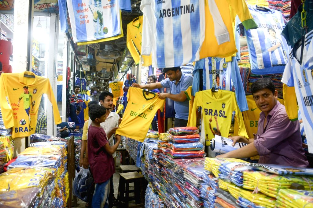 DHAKA, May 27, 2018 - Vendors and buyers are seen at a market selling the customized shirts of the FIFA World Cup participating teams in Dhaka of Bangladesh, on May 27, 2018.