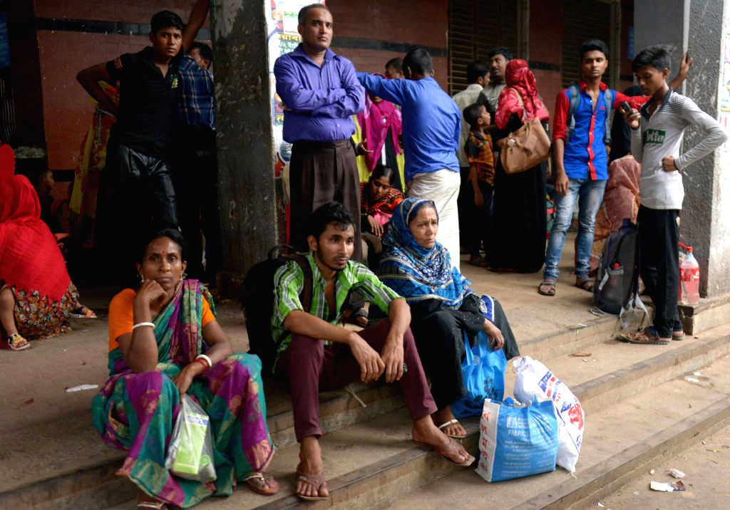 DHAKA, May 29, 2017 - Photo taken on May 29, 2017 shows stranded passengers waiting in the departure area at Sadarghat launch terminal in Dhaka, capital of Bangladesh, after ferry services were ...