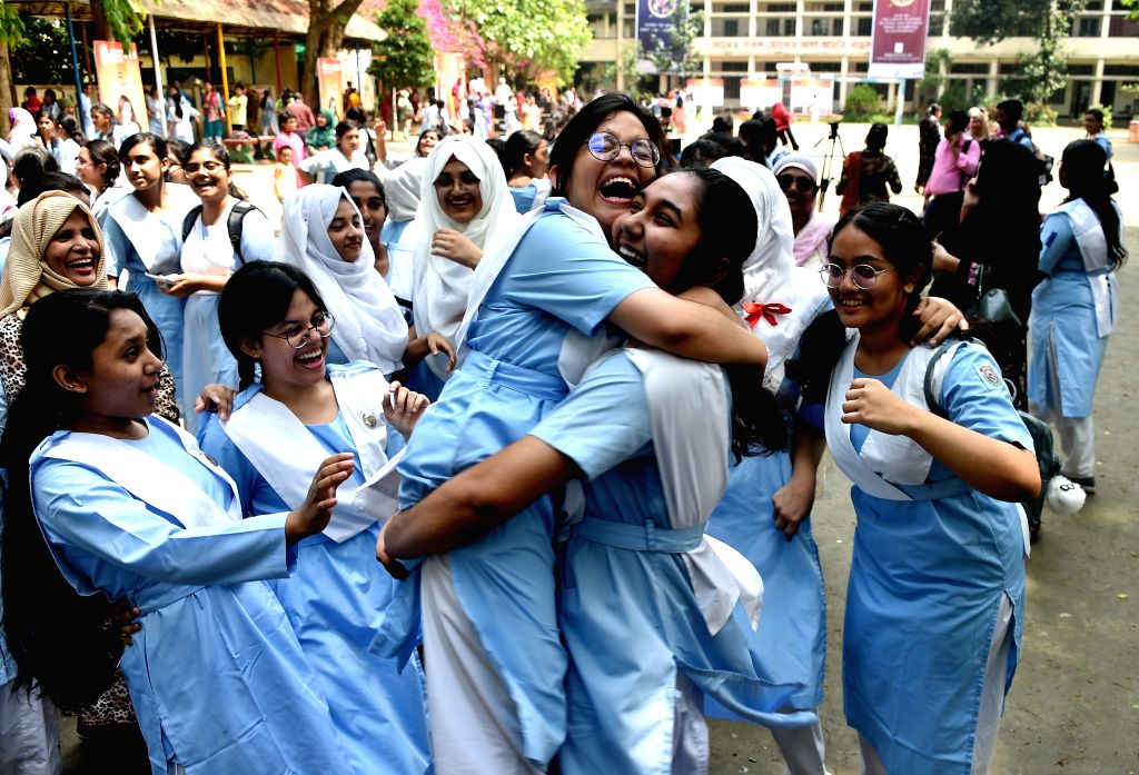 DHAKA, May 6, 2019 - Girls celebrate after checking their high school exam results in Dhaka, Bangladesh, May 6, 2019. Over 2.3 million students took part in this year's Secondary School Certificate ...
