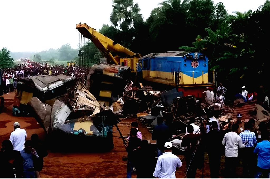 DHAKA, Nov. 12, 2019 - A crane is deployed to remove derailed compartments after a collision between two trains at a station in Bangladesh's Brahmanbaria district, some 109 km northeast of capital ...