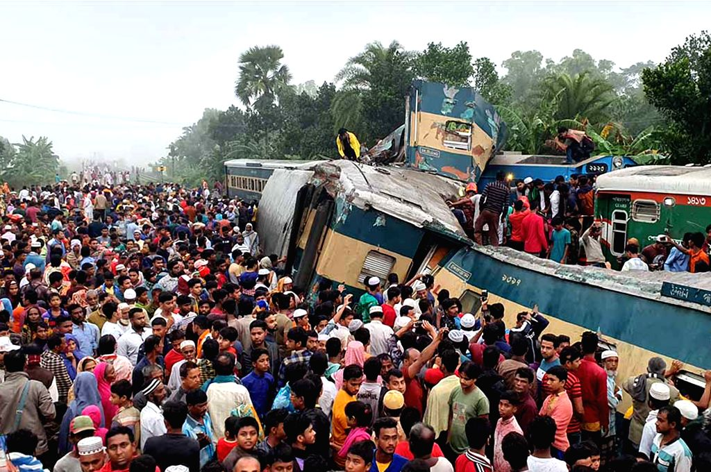DHAKA, Nov. 12, 2019 - People gather at the accident site after a collision between two trains in Bangladesh's Brahmanbaria district, some 109 km northeast of capital Dhaka, on Nov. 12, 2019. ...