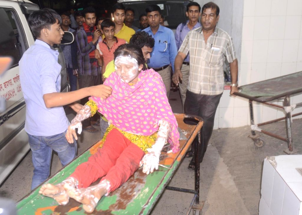 DHAKA, Nov. 23, 2016 - An injured female worker is transferred to a hospital in Dhaka, capital of Bangladesh, Nov. 22, 2016. Dozens of workers, mostly women, sustained injuries as a fire broke out at ...