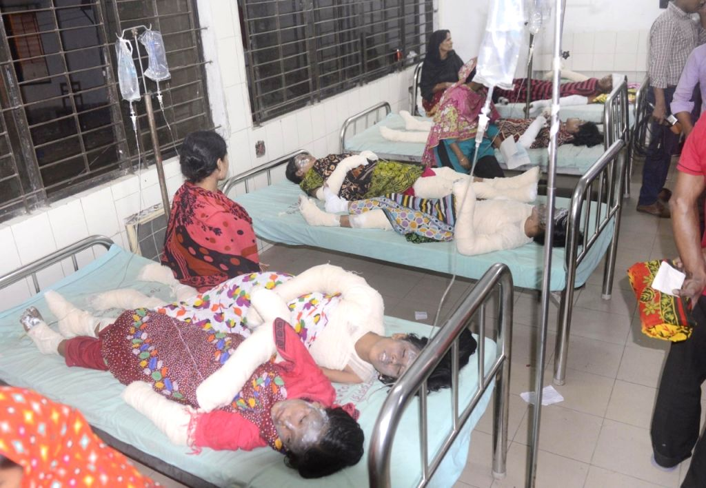 DHAKA, Nov. 23, 2016 - Female workers who were injured during a factory fire receive treatment at a hospital in Dhaka, capital of Bangladesh, Nov. 22, 2016. Dozens of workers, mostly women, sustained ...