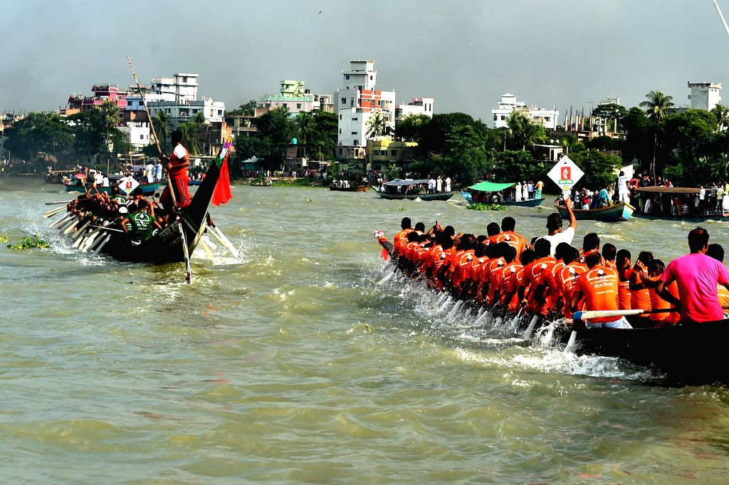 DHAKA, Oct. 12, 2019 - Photo taken on Oct. 11, 2019 shows boatmen paddle during a traditional boat race on the Buriganga River in Dhaka, Bangladesh.
