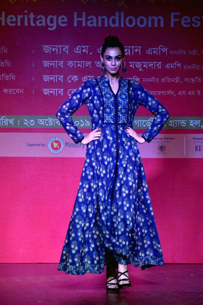 DHAKA, Oct. 25, 2019 - A Bangladeshi model presents clothing with native cultural characteristics during the Heritage Handloom Festival 2019 in Dhaka, Bangladesh, Oct. 23, 2019. The four-day event ...