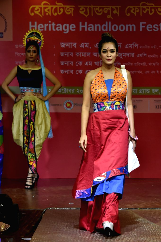 DHAKA, Oct. 25, 2019 - Bangladeshi models present clothing with native cultural characteristics during the Heritage Handloom Festival 2019 in Dhaka, Bangladesh, Oct. 23, 2019. The four-day event ...