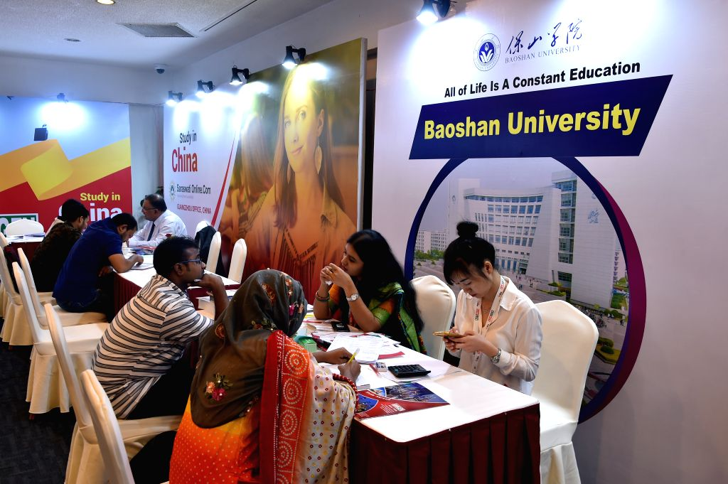 "DHAKA, Oct. 26, 2019 - Students collect admission information during ""China Education Expo-2019"" in Dhaka, Bangladesh on Oct. 25, 2019. A two-day ""China Education Expo-2019"" ..."