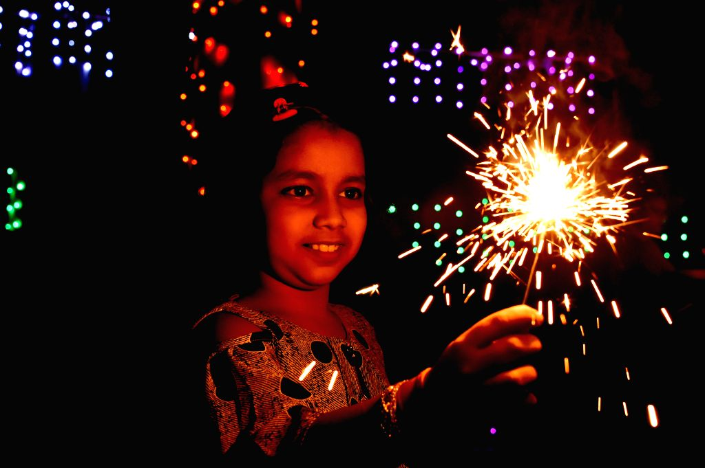 DHAKA, Oct. 28, 2019 - A Hindu child plays with firecrackers to celebrate Diwali, the Hindu Festival of Lights, in Dhaka, Bangladesh on Oct. 27, 2019.