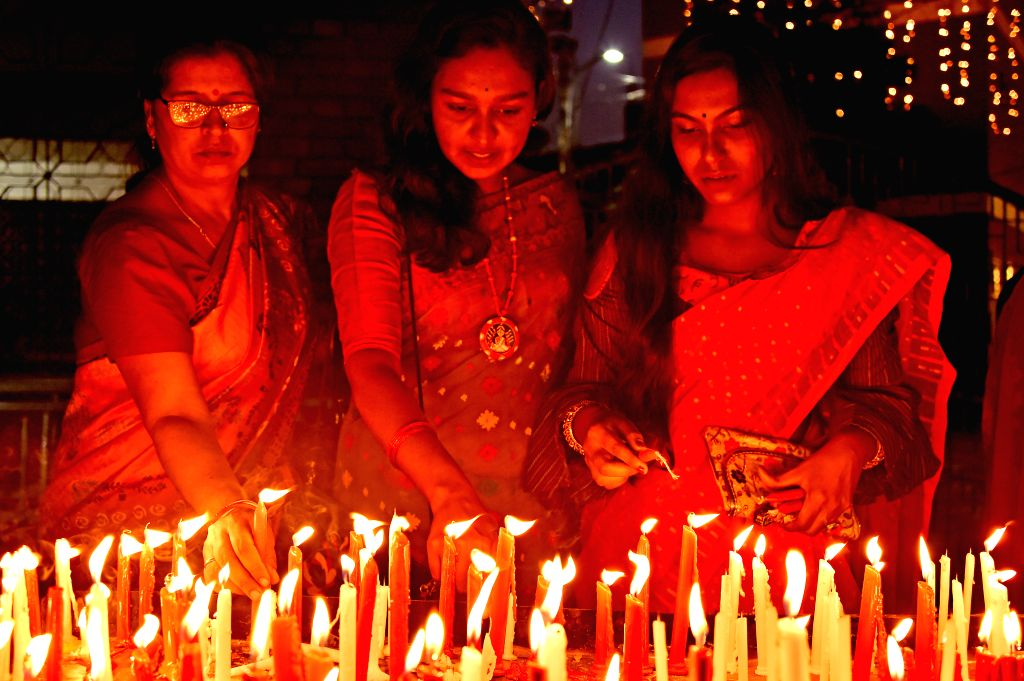 DHAKA, Oct. 28, 2019 - Women light candles to celebrate Diwali, the Hindu Festival of Lights, in Dhaka, Bangladesh on Oct. 27, 2019.