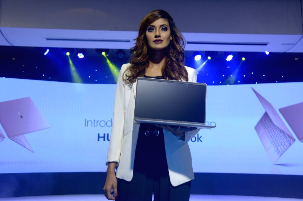 DHAKA, Oct. 6, 2017 - A model presents a Huawei MateBook at a launching ceremony in Dhaka, Bangladesh, on Oct. 5, 2017. China's telecommunication giant Huawei has introduced here its first Windows ...