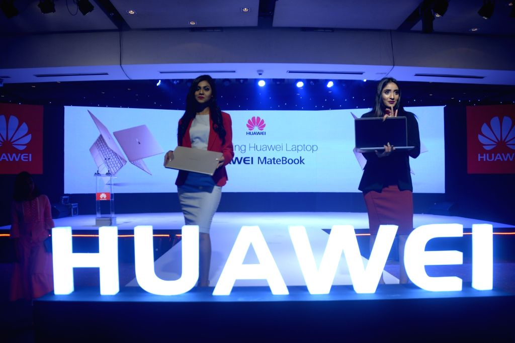 DHAKA, Oct. 6, 2017 - Models present Huawei MateBooks at a launching ceremony in Dhaka, Bangladesh, on Oct. 5, 2017. China's telecommunication giant Huawei has introduced here its first Windows ...