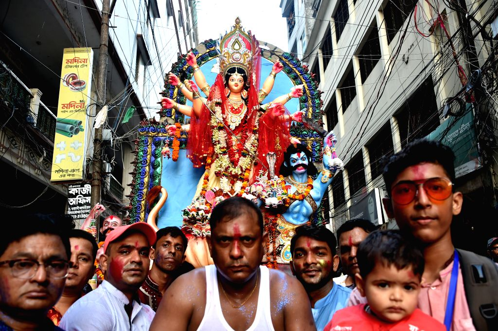 DHAKA, Oct. 8, 2019 - Hindu devotees carry an idol of Durga Goddess to a river in Dhaka, Bangladesh, on Oct. 8, 2019. Security arrangements across Bangladesh were beefed up for the peaceful ...