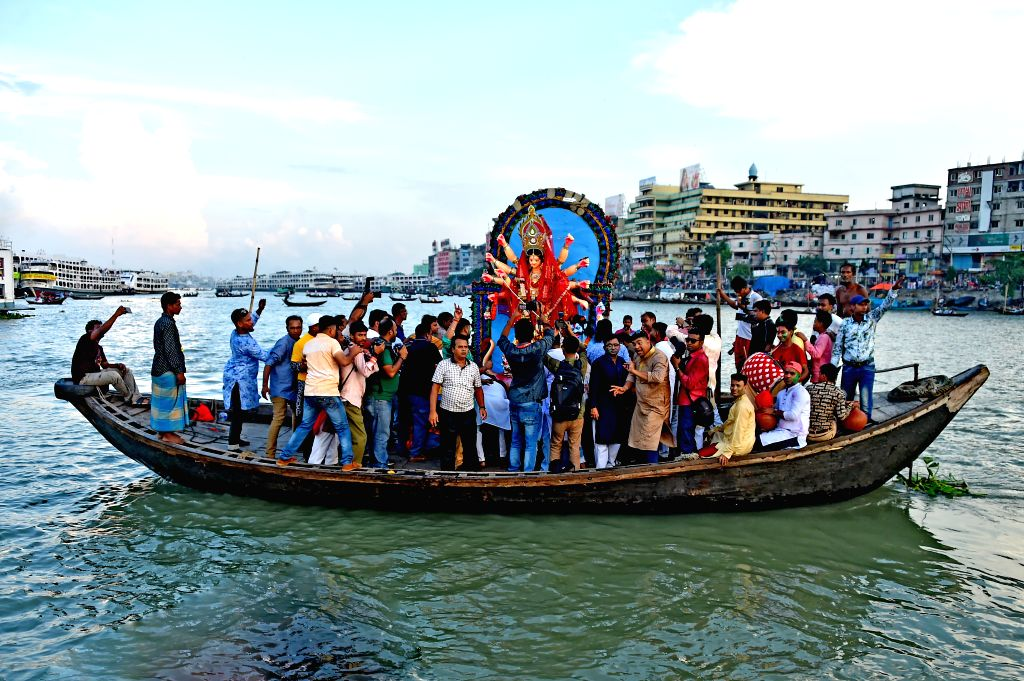 DHAKA, Oct. 8, 2019 - Hindu devotees prepare to immerse an idol of Durga Goddess into a river in Dhaka, Bangladesh, on Oct. 8, 2019. Security arrangements across Bangladesh were beefed up for the ...