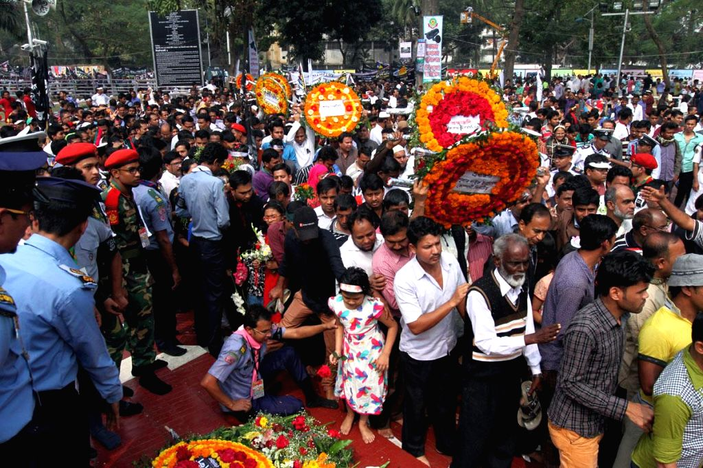 People at the central Shaheed Minar pay tribute to Language Movement in Dhaka, Bangladesh, on Feb 21, 2015.