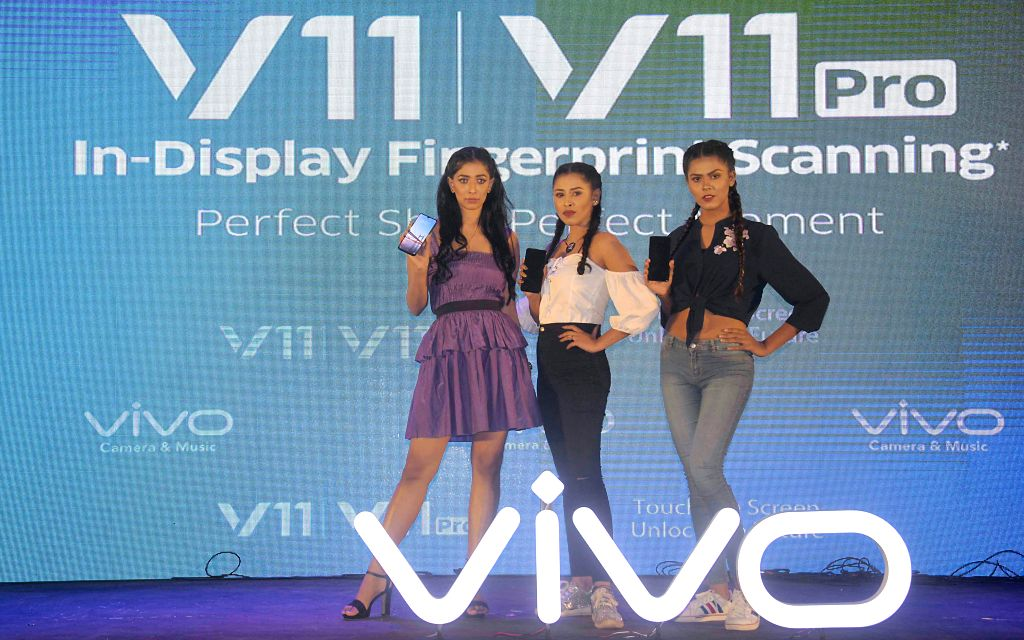 DHAKA, Sept. 15, 2018 - Models present smartphones V11 Pro at launching ceremony in Dhaka, Bangladesh, on Sept. 14, 2018. China's smartphone producer Vivo officially unveiled its latest flagship ...
