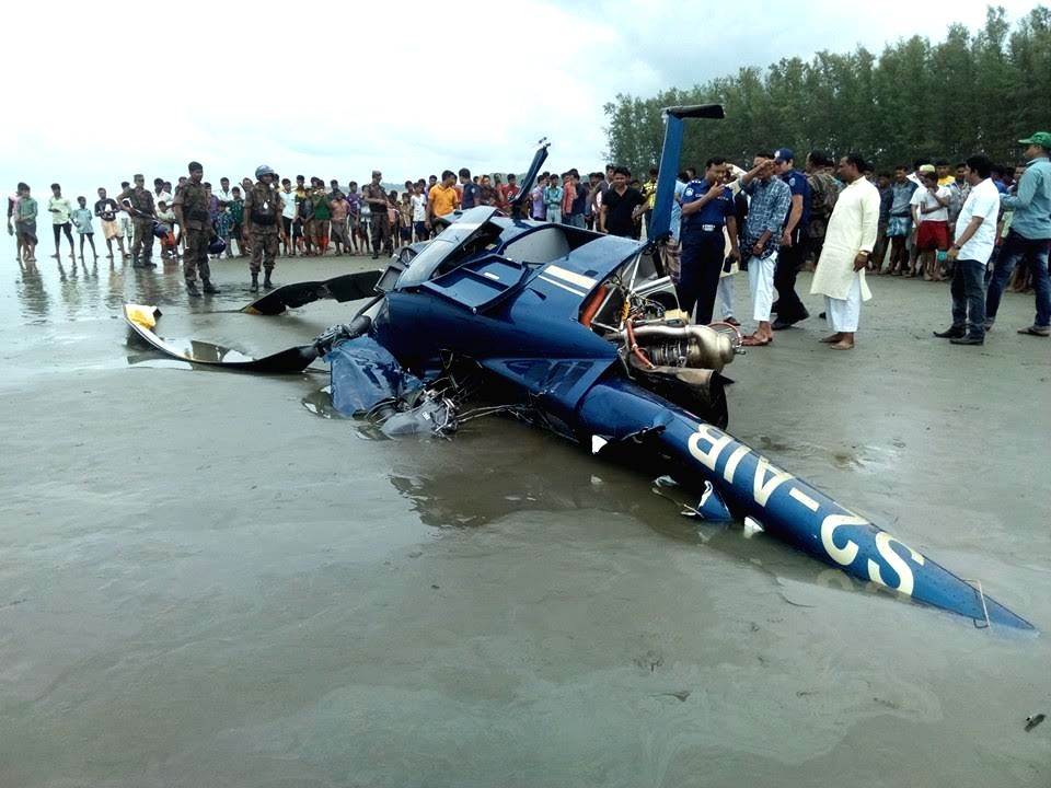 DHAKA, Sept. 16, 2016 - People gather at the site of a helicopter crash in Bangladesh's Cox's Bazar, some 292 km southeast of capital Dhaka, Sept. 16, 2016. One person was killed while four others ...