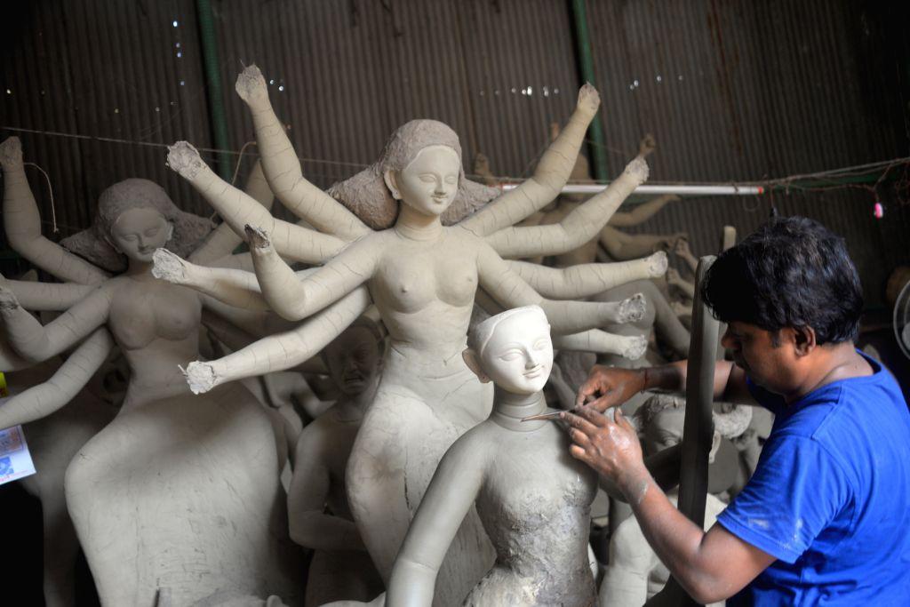 DHAKA, Sept. 18, 2018 - An artist works on clay idols of Hindu Goddesses for the upcoming Durga Puja festival in Dhaka, Bangladesh, Sept. 18, 2018.