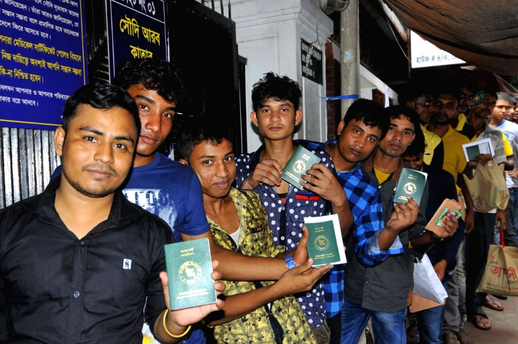 DHAKA, Sept. 19, 2016 - Bangladesh people hold their passports as they queue up for medical examinations as part of official requirements to get employment in Saudi Arabia, at a clinic in Dhaka's ...