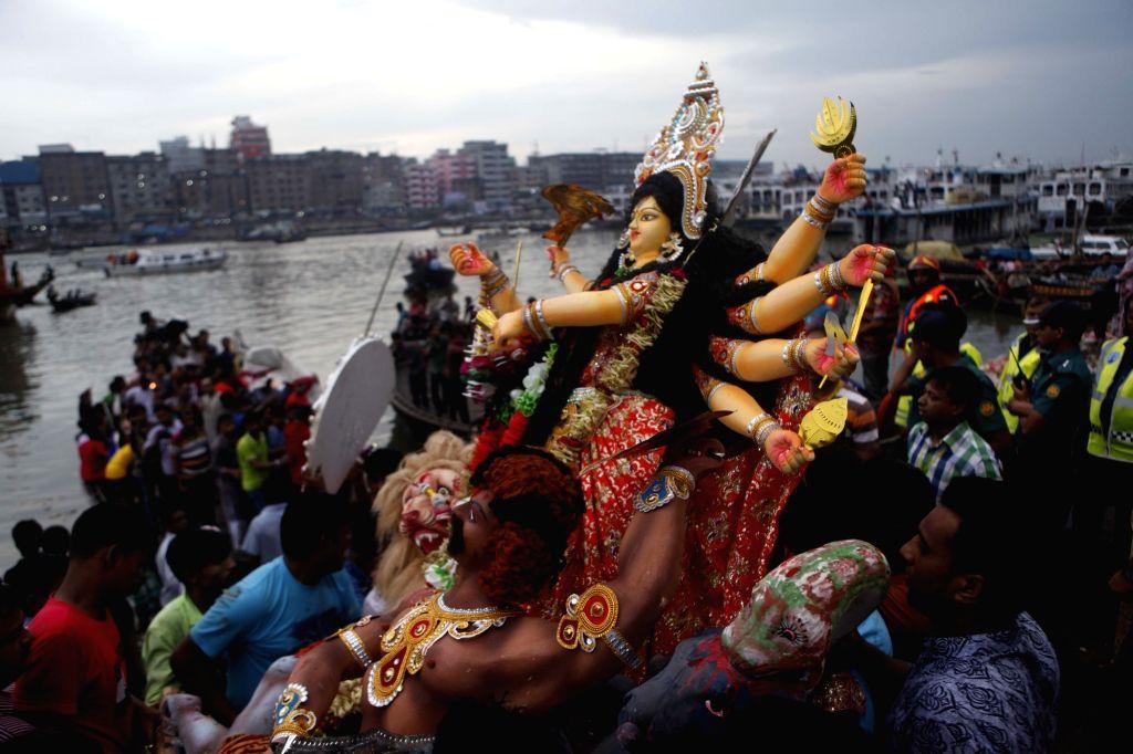 DHAKA, Sept. 30, 2017 - Hindu devotees celebrate Durga festival in Dhaka, Bangladesh, Sept. 30, 2017. The annual festival celebrates the worship of Durga, the Hindu goddess symbolizing power and the ...