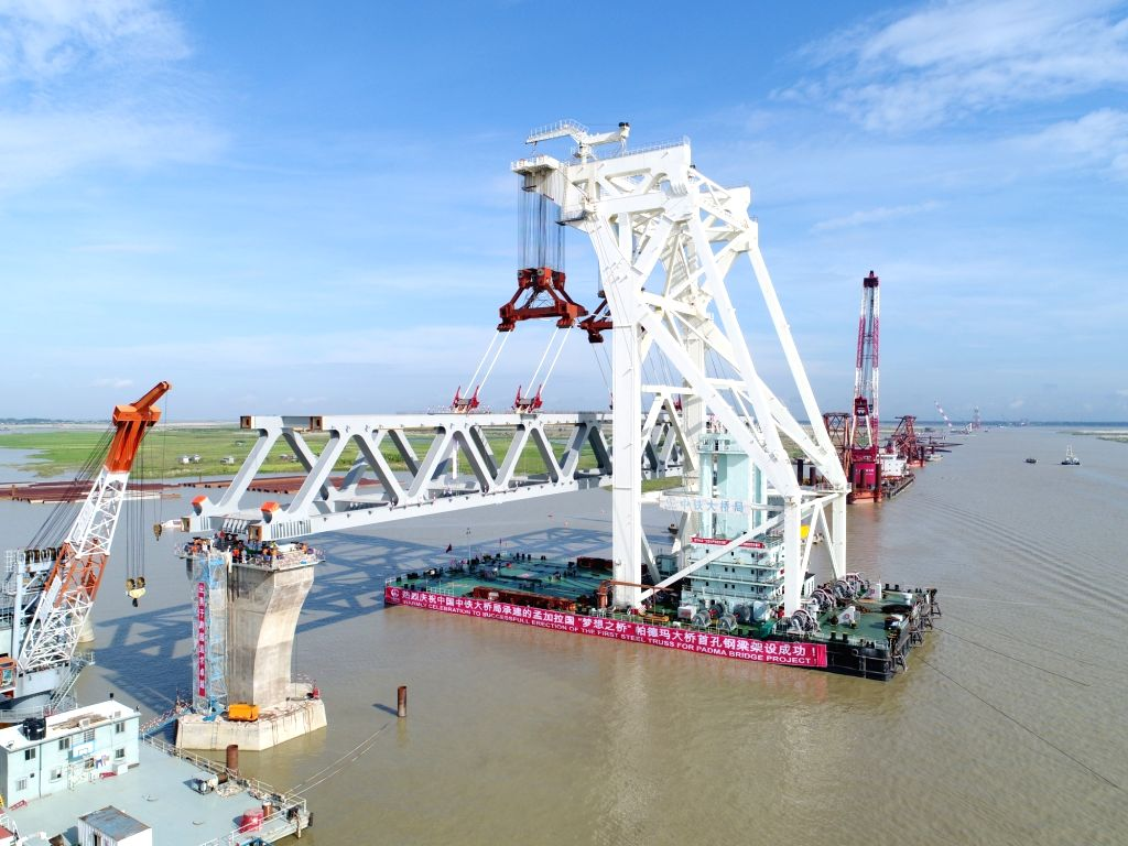 DHAKA, Sept. 30, 2017 - Photo taken on Sept. 30, 2017 shows the first span of Padma Bridge being installed in Bangladesh. Bangladesh's largest Padma Bridge is now visible as its very first span was ...