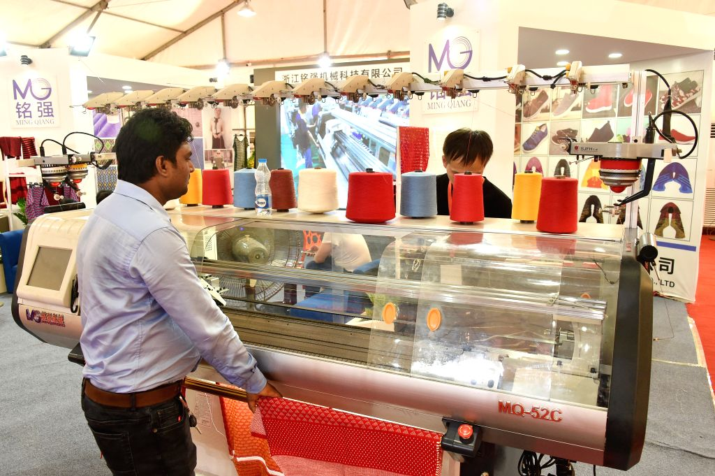 DHAKA, Sept. 4, 2019 - A visitor looks at sewing thread bundles during the 20th Textech Bangladesh International Expo 2019 in Dhaka, Bangladesh, on Sept. 4, 2019. The 20th edition of the annual ...