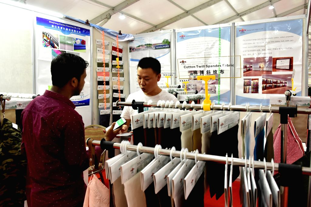 DHAKA, Sept. 4, 2019 - A visitor visits a stall during the 20th Textech Bangladesh International Expo 2019 in Dhaka, Bangladesh, on Sept. 4, 2019. The 20th edition of the annual international ...