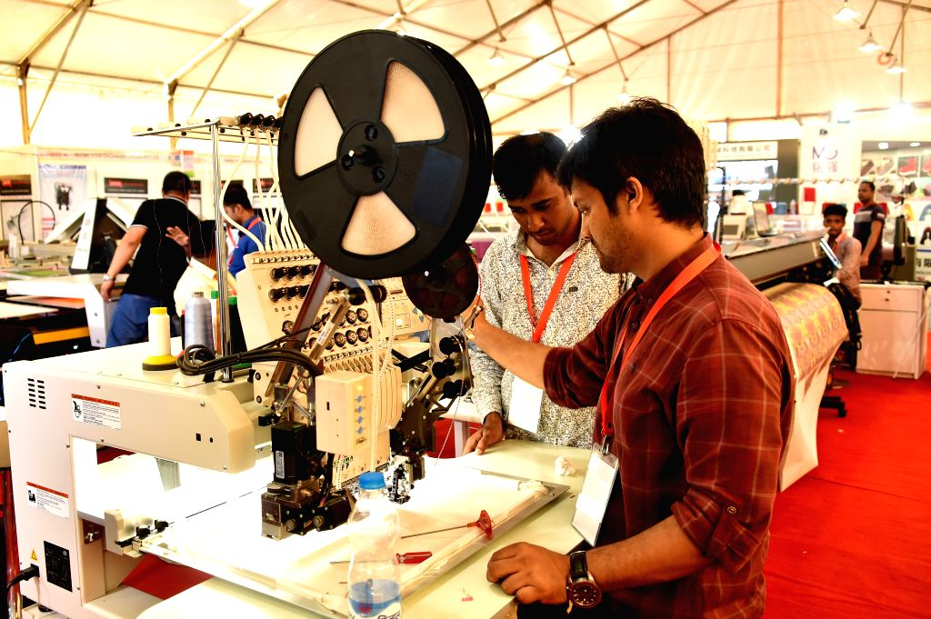 DHAKA, Sept. 4, 2019 - Visitors look at products during the 20th Textech Bangladesh International Expo 2019 in Dhaka, Bangladesh, on Sept. 4, 2019. The 20th edition of the annual international ...
