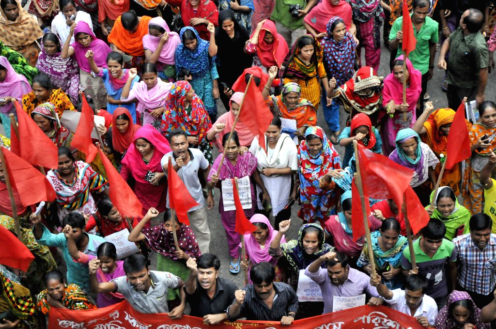 Garment workers from Toba Group Factory attend a protest rally in front of the National Press Club in Dhaka, Bangladesh, Sept. 7, 2014. Hundreds of garment workers ...