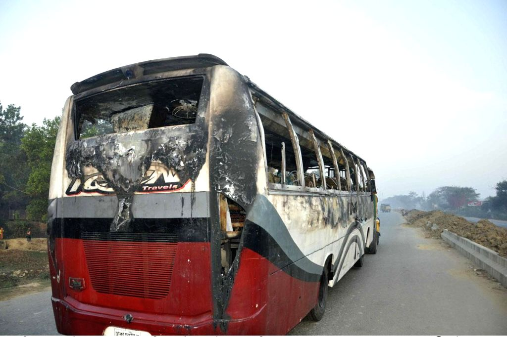 Seven people burnt alive and 25 others injured when a petrol bombs were hurled at a bus at Dhaka-Chittagong highway, Bangladesh on Feb. 3, 2015.