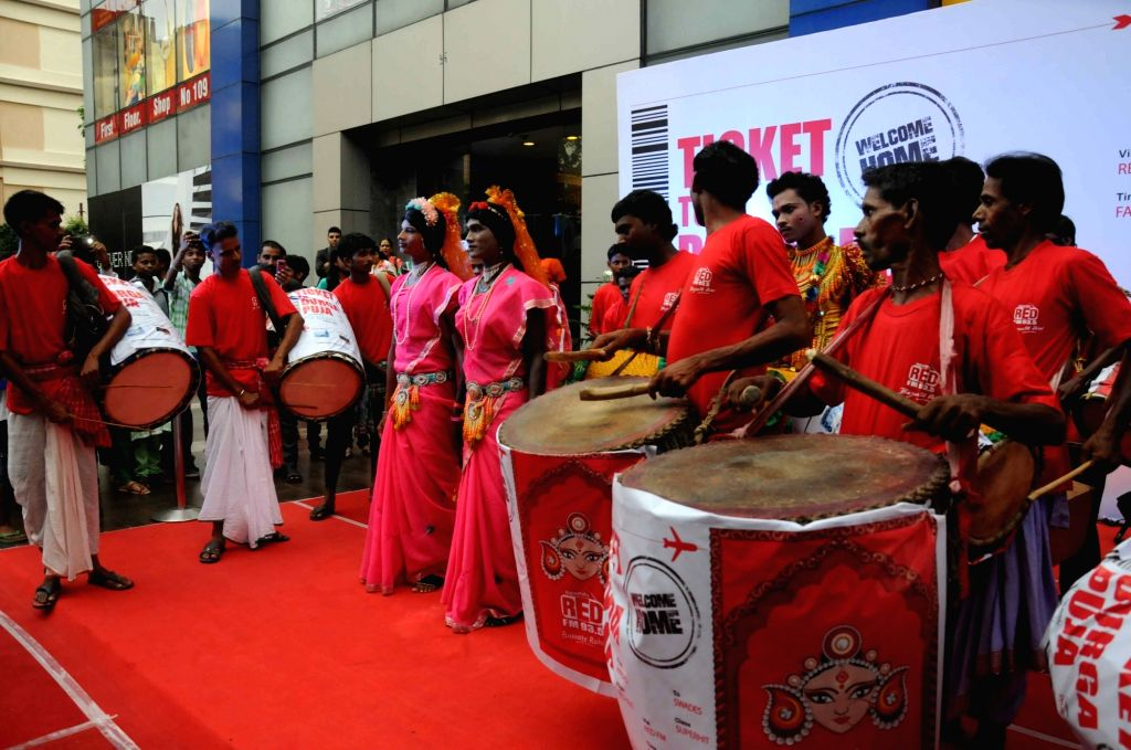 Dhakis (drummers) participate in a competition organised at Kolkata mall during Durga Puja on Oct 4, 2016.