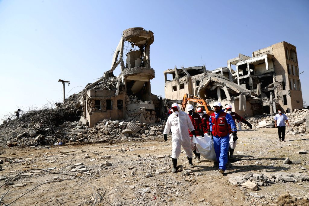 DHAMAR, Sept. 4, 2019 - A rescue team searches for victims among rubble of a building hit by airstrikes, in Dhamar province, Yemen, Sept. 4, 2019. The United Nations Special Envoy to Yemen Martin ...