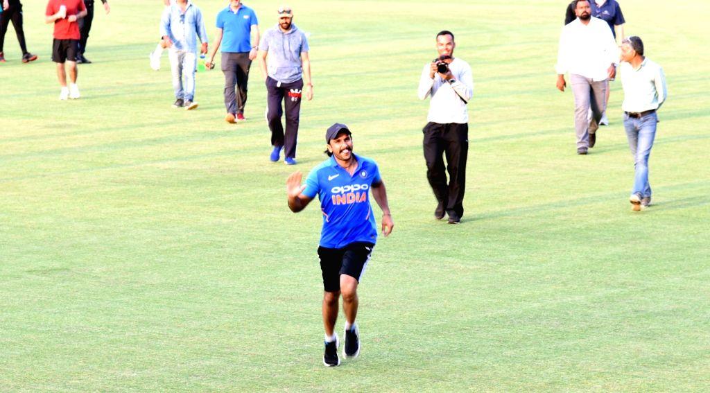 """Dharamsala: Actor Ranveer Singh during shooting of upcoming film """"83"""" at Himachal Pradesh Cricket Association Stadium in Dharamsala on April 4, 2019. (Photo: IANS) - Ranveer Singh"""