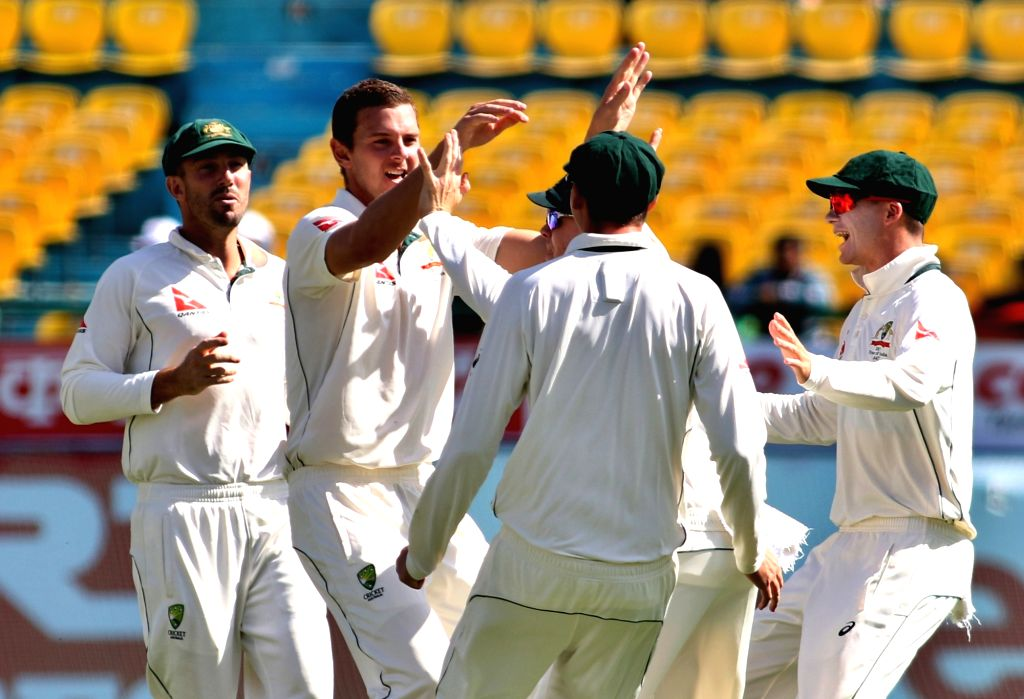 Dharamsala: Australian player Josh Hazlewood celebrates the wicket of Murali Vijay during the second day of play of the fourth and last cricket test match between India and Australia in Dharamsala on March 26, 2017. (Photo: Surjeet Yadav/IANS) - Surjeet Yadav