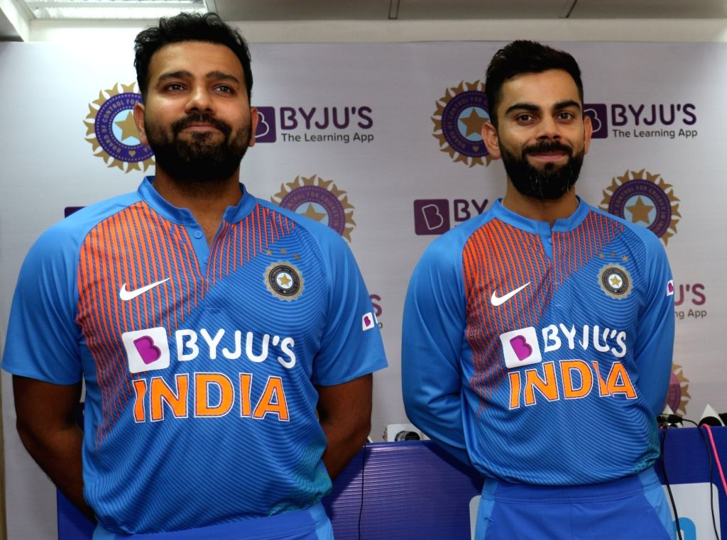 Dharamsala: Indian cricketers Rohit Sharma and Virat Kohli showcase the team's new jersey at a press conference on the eve of their first T20I match against South Africa, at Himachal Pradesh Cricket Association Stadium in Dharamsala on Sep 14, 2019.  - Rohit Sharma, Virat Kohli and Surjeet Yadav